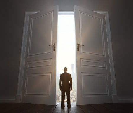 thinking cloud: businessman in room with big door to city
