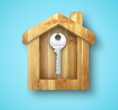 metal key hanging in a wooden house photo
