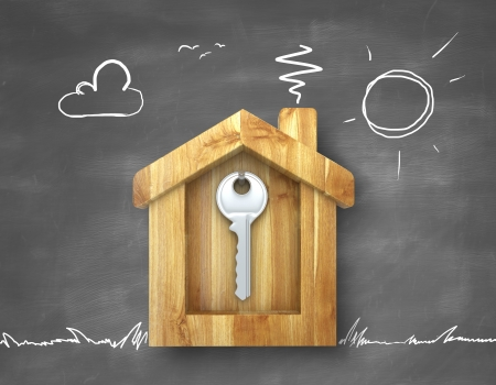 key hanging in a wooden house Stock Photo - 22648338