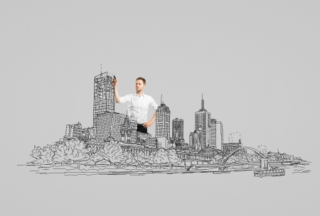 businessman drawing abstract city  photo