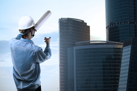 builder standing and pointing at downtown Stock Photo - 22768135