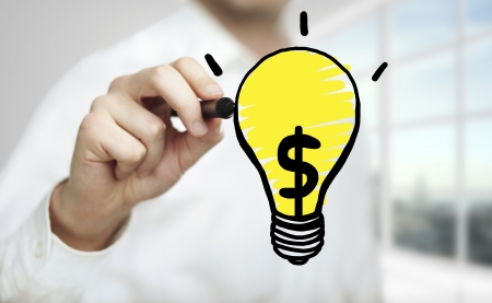 man drawing lamp with dollar symbol Stock Photo - 22768187