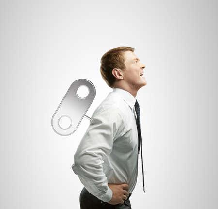 winder: happy businessman with winder on back