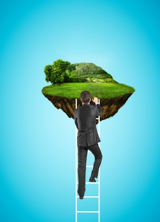 businessman climbing to island in sky with green field photo