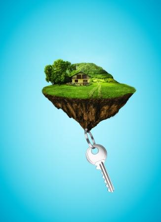 house: eiland in de hemel met huis en sleutel Stockfoto