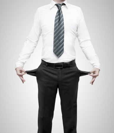 inside out: businessman standing with pockets turned inside out Stock Photo