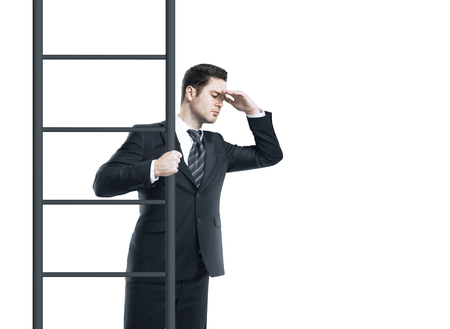 climbing ladder: businessman standing on ladder and looking Stock Photo