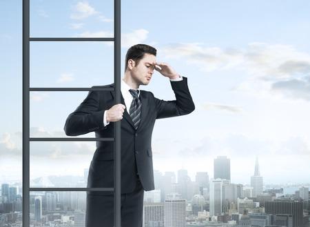 climbing ladder: businessman climbing on ladder, urban business concept