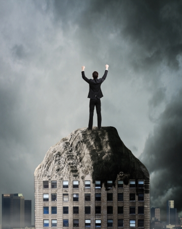 destroyed: happy businessman standing on top of a destroyed house