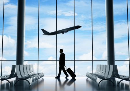 business men: man in airport and airplane in sky
