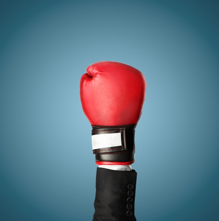 hand in boxing gloves isolated on blue Stock Photo