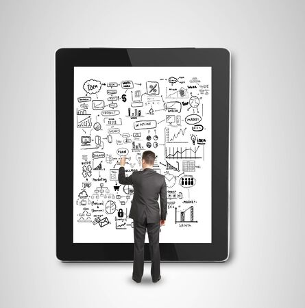 businessman drawing concept on touch pad Stock Photo - 23186879
