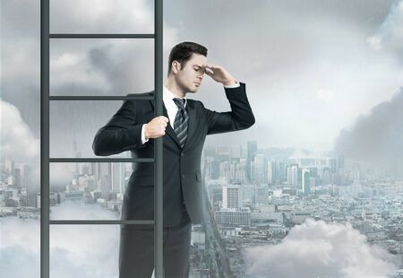 businessman climbing on ladder, urban business concept photo