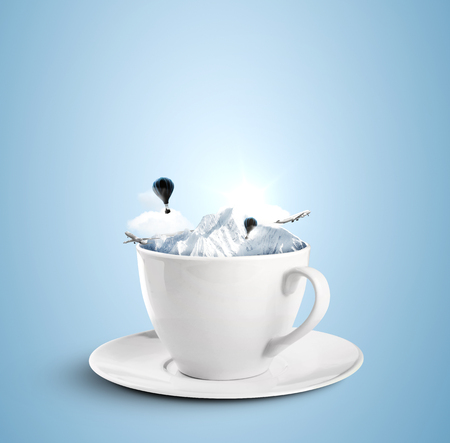 cup with mountains and flying around air baloons and planes Stock Photo
