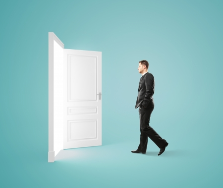 businessman walking to opened door