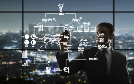 businessman drawing interface in night office photo