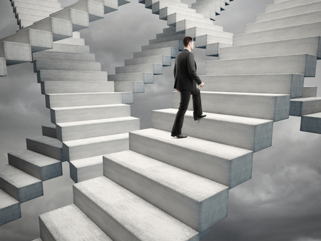 difficult journey: businessman climbing stairs in bad weather
