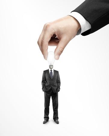 twists: hand twists bulb in the head businessman