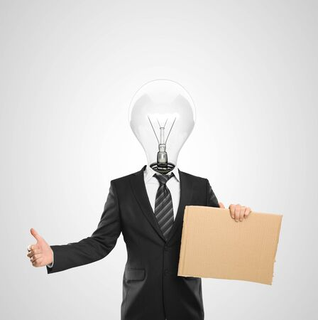 businessman with a light bulb for a head holding poster Stock Photo