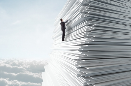 businessman climbing up a huge stack of paper in sky Stock Photo - 23371341