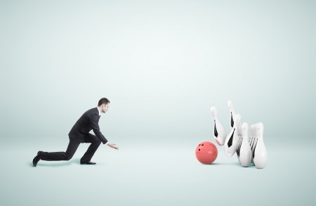 businessman in suit playing bowling photo