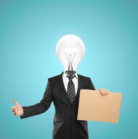 businessman with a light bulb for a head holding  cardboard