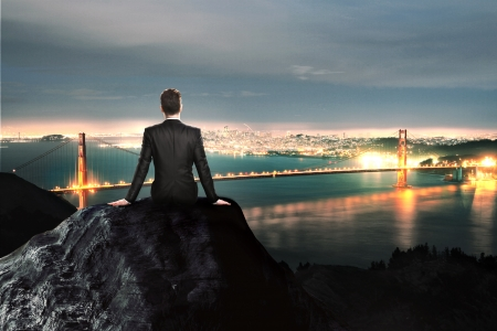businessman sitting on a city background photo