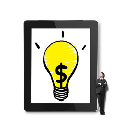 businessman looking at big  touch pad with lamp photo