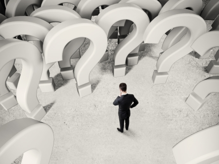 businessman thinking on many questions marks photo