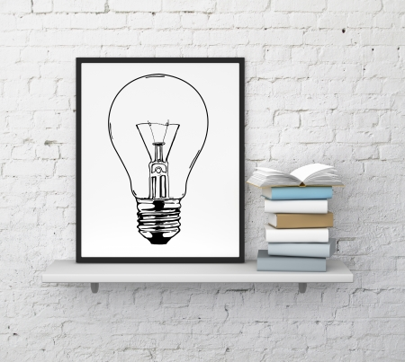 shelf wall: frame with drawing lamp on shelf  and book
