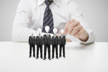 twists: hand twists lamp in head businessmans