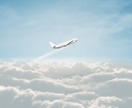 airplane flayng in blue sky Stock Photo
