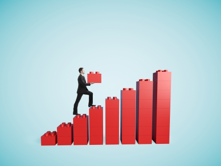 incentive: businessman climbing to red conctructor stair and holding block Stock Photo