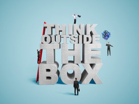 think outside the box with several businessman photo