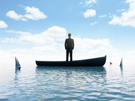 businessman man thinking  boat with sharks around him photo