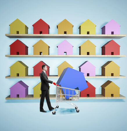 market research: businessman in market bying cottage Stock Photo