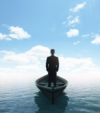 businessman standing on a boat and looking to sky Stock Photo - 23756179