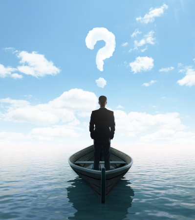 businessman standing on a boat with question mark Stock Photo - 23756180