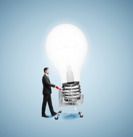 businessman walking with cart and bying bulb photo