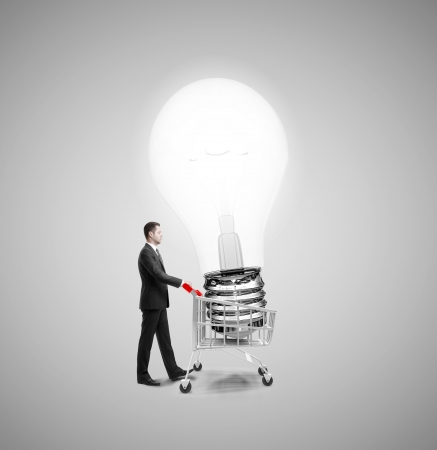 businessman with cart and bying bulb photo