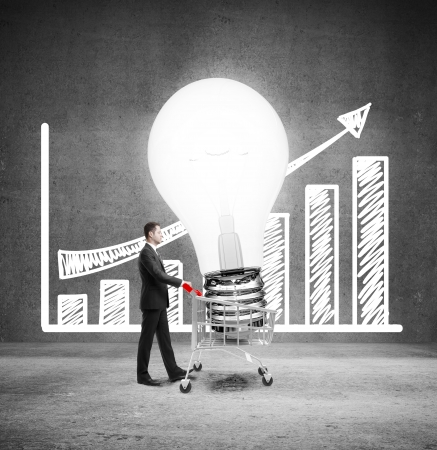 businessman with cart and bying lightbulb bulb, idea concept photo