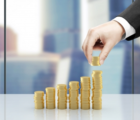 businessman hand holding coins in office Stock Photo - 23926121