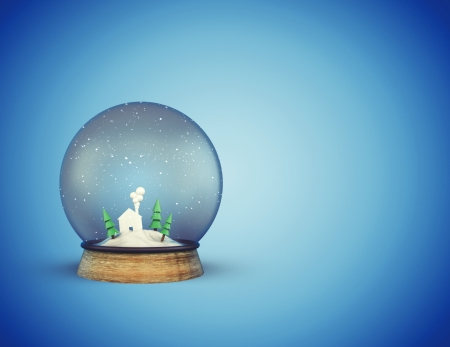 foreshadowing: christmass glass ball with house and trees on blue background
