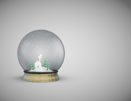 foreshadowing: christmass glass ball with house and trees on gray background Stock Photo