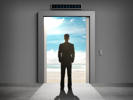 businessman looking at opened elevator photo