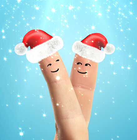 hand with small Santa hats on fingers photo