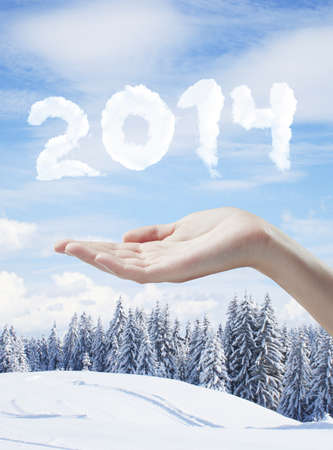 schneeberg: hand holding 2014 new year concept Stock Photo