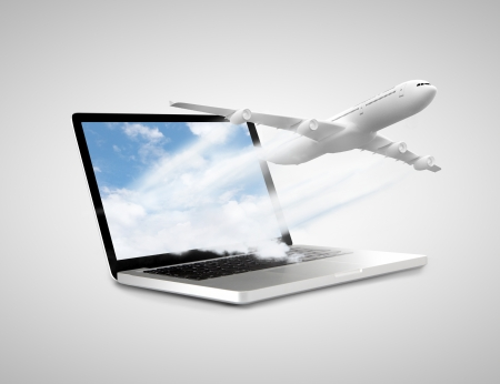 laptop with airplane on a white background photo