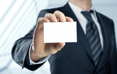 businessman holding paper visit card