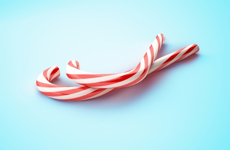 candy merry christmas on blue background Stock Photo - 24125397